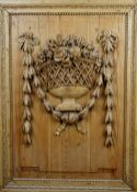 A 19th century pine and limewood relief carving depicting ribbon tied floral sprays in an open