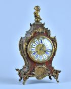 A French giltmetal-mounted Boulle work mantel clock In the Louis XV style,