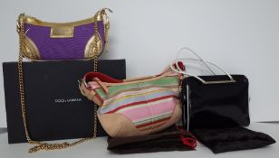 A collection of three designer handbags,