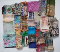 A collection of five Liberty of London printed silk scarves,