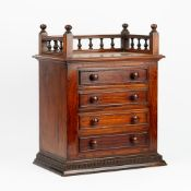 A 19th century walnut table top chest with a galleried top over four long graduated drawers,