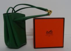A Hermes green grained leather Vespa pouch,