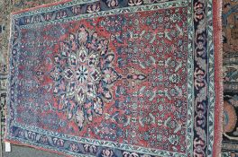 A Mahal rug, Persian, the madder field with a bold medallion,