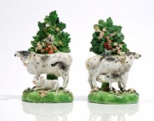 A pair of Derby porcelain cow and calf groups, early 19th,