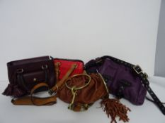 A collection of four designer handbags, comprising; a Phillip Lim 3.