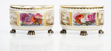 A pair of Ridgway porcelain demi-lune bulb pots, circa 1810-15, each raised on three paw feet,