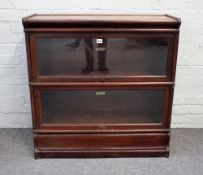 The Globe Wernicke Co Limited, a two section mahogany bookcase with up and over glazed doors,
