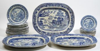 A group of Staffordshire blue and white printed Willow pattern earthenware, 19th century,