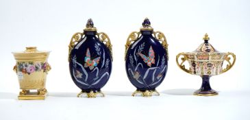 A pair of English porcelain blue-ground two-handled vases and two covers, late 19th century,
