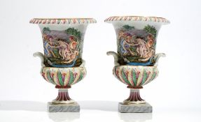 A pair of Italian Capodimonte style campana shaped two-handled urns, late 19th century,