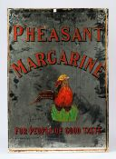 An early 20th century advertising mirror for Pheasant Margarine,