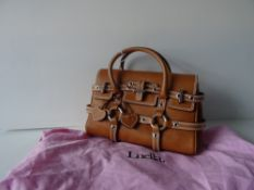 A Luella 'Giselle' tan leather handbag, with twin leather loop handles and strap decoration,