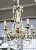 A 20th century French gilt metal and cut glass six-light chandelier, 57cm high.