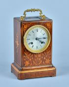A Louis Philippe giltmetal-mounted rosewood and marquetry inlaid mantel clock With glazed upper