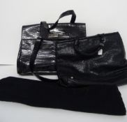A Donna Karen New York black leather crocodile effect twin handled work bag,