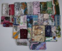 A collection of mainly souvenir silk scarves and handkerchiefs and a collection of graphic drawn