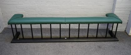 A Victorian style black painted steel and green leather upholstered club fender,