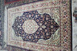 A Hereke silk and metal thread rug, Turkish,
