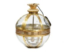 A modern lacquered brass globe lantern with an internal four light pendant, fitted for electricity,
