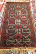 A Belouche rug, the shaped field with four diamonds, a 3-line and leaf border, 145cm x 85cm.