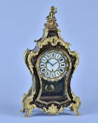 An English boulle work mantel timepiece In the Louis XV style, By Arnold, 84 Strand, London, No.