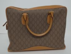 A Gucci GG lady's canvas and tan leather soft briefcase,