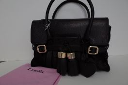 A Luella black leather and pony skin handbag with gold-tone hardware,