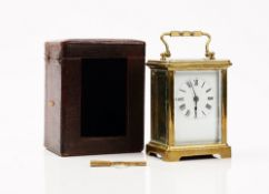 An late 19th century French brass cased carriage clock, with leather travelling case and winder,