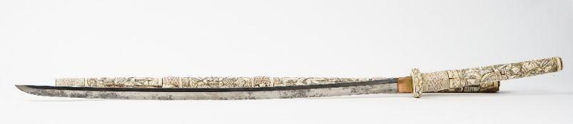 A Japanese carved bone long sword Meiji period, the hilt and scabbard carved in relief with figures,