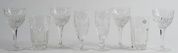 A part suite of cut glass drinking glasses, comprising; ten white wine glasses, 15cm.