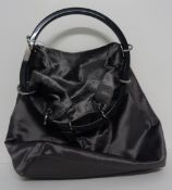 A Gucci lady's silver satin evening bag, of hoop drawstring design,