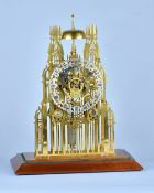A late Victorian 'York Minster' brass Skeleton clock With twin chain fusee movement with anchor