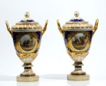 A pair of Berlin porcelain cobalt blue and apricot ground two- handled vases and covers,