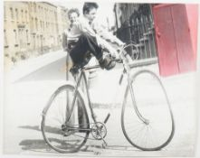 Nigel Henderson (British, 1917-1985), Stressed Photograph of Boys on Bike,