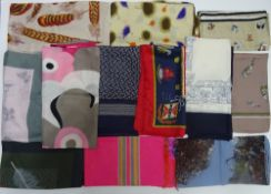 A collection of twelve designer and printed various silk scarves,