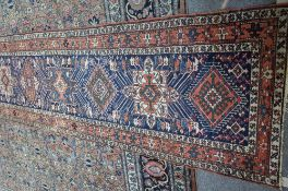 A North Western Persian runner, the indigo field with eleven single medallions,