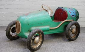 A 1950s Triang Super 8 Racer pedal car, repainted in green, with four 13inch pneumatic tyres,