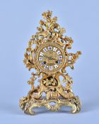A French giltmetal mantel clock In the Louis XV style,