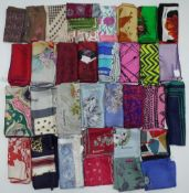 A large collection of printed silk scarves mainly designed by Jaqmar of London (35)