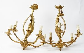 A pair of 20th century gilt metal five branch chandeliers and ceiling roses, in the rococo style,