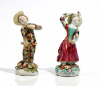 A matched pair of Bow figures of children dressed as Harlequin and Columbine, circa 1760,