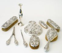 A Sterling silver mounted lady's eight piece dressing set, comprising; a hand mirror, a hairbrush,