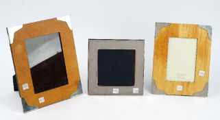 A silver mounted rectangular wooden photograph frame, size of frame 26.4cm x 21.
