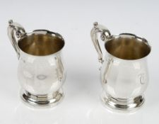 A pair of silver mugs, each of baluster form,
