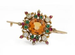 A late 19th/early 20th entury topaz, emerald, ruby and diamond brooch,