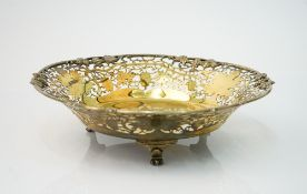 A silver gilt dish, of shaped circular form, cast and pierced with a border of fruiting vine,
