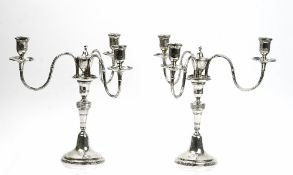 A pair of Portuguese three light table candelabra,