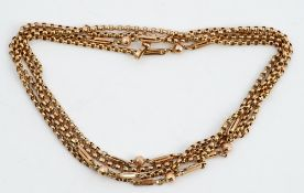 A 9ct gold fancy belcher link long chain, interspersed with bead and baton links, 32.