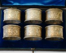Six Victorian silver napkin rings, each with engraved decoration within beaded rims, numbers 4,