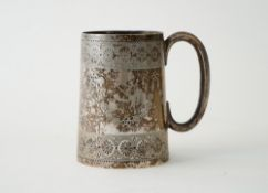 A Victorian silver christening mug, of tapered cylindrical form, with a 'C' shaped handle,